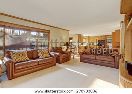 Traditional living room with white caret, and simple decor. - stock photo