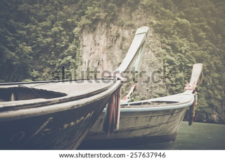 Traditional Long Boat in Thailand with Vintage Instagram Style Filter - stock photo