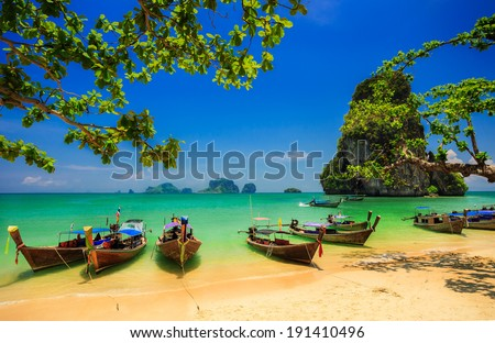 Traditional longtail boat at sunset on tropical island, Thailand - stock photo