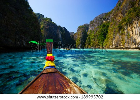 Traditional longtail boat in pile bay on Koh Phi Phi Leh Island, Krabi, Southern of Thailand - stock photo
