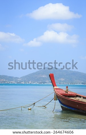 traditional longtail boat in the sea from Phuket Thailand - stock photo