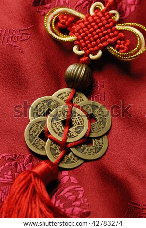 Traditional lucky knot on Jin-Silk background. - stock photo