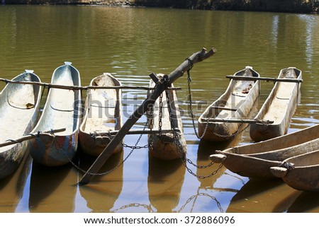 Traditional malagasy boat- canoe, africa, madagascar - stock photo