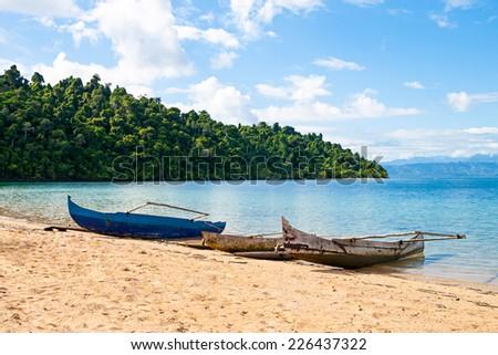 traditional Malagasy boat. Madagascar - stock photo