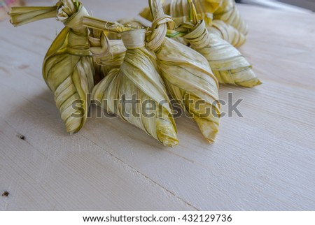 Traditional Malay cuisine called 'ketupat' made from glutinous rice. - stock photo