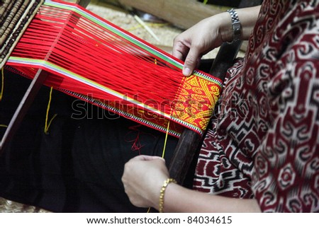 traditional malaysian loom detail - stock photo