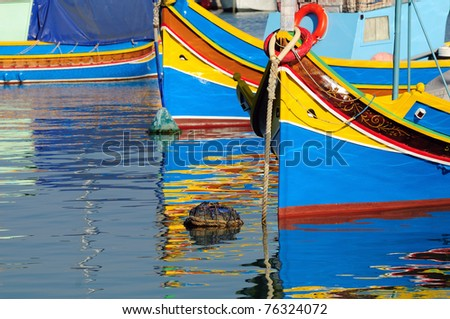 Traditional Maltese fishing boat with reflection - stock photo