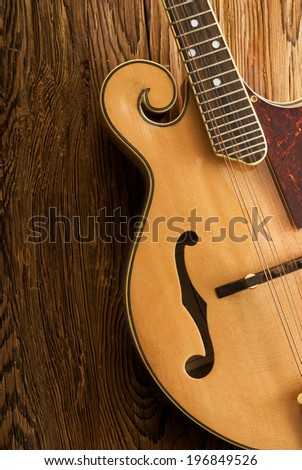 traditional mandolin on wood table,close up - stock photo