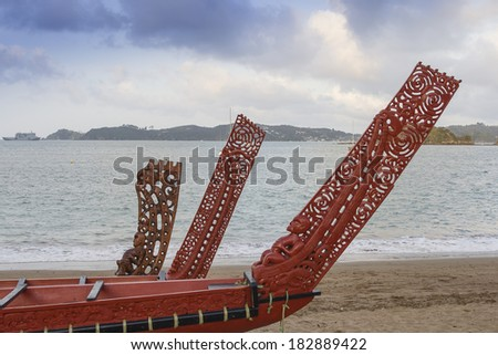 Traditional Maori wood carved canoes on the shore at Waitangi n New Zealand   - stock photo