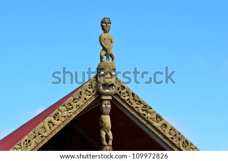 Traditional Maori wood carvings in a Marae (meeting house) in New Zealand. - stock photo