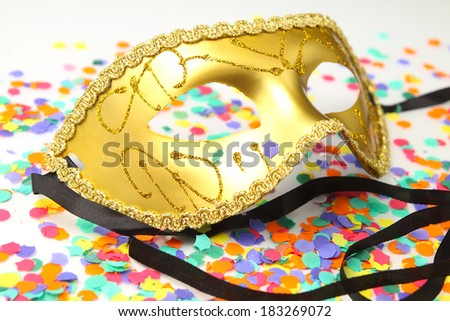 Traditional mask on a background of confetti - stock photo