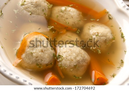 Traditional Matzah Ball Soup for Jewish Passover - stock photo