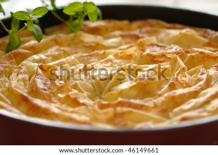 Traditional meal from Bulgaria - Banica made of filo pastry leaves stuffed with feta cheese - stock photo