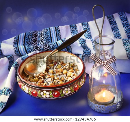 """Traditional meal in eve Christmas """"Kutya"""" on a background a lantern - stock photo"""