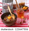 "Traditional meal in eve Christmas ""Kutya"" with a fruit fruit compote on a background a lantern - stock photo"