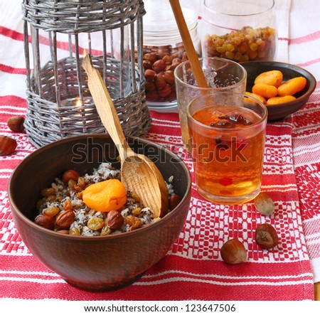"""Traditional meal in eve Christmas """"Kutya"""" with a fruit fruit compote on a background a lantern - stock photo"""