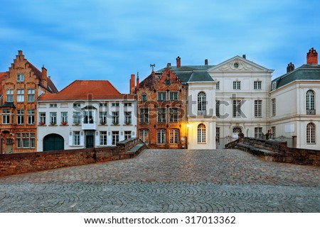 Traditional medieval red and white brickwall architecture of Bruges at twilight - stock photo