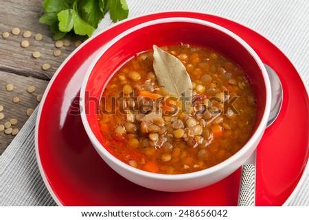 Traditional Mediterranean lentil stew in bowl. - stock photo