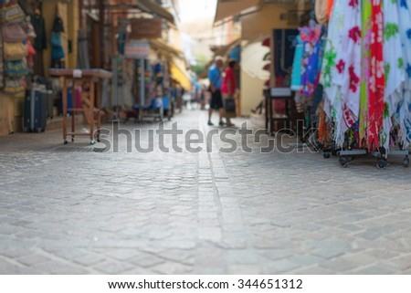 Traditional mediterranean street with goods. - stock photo