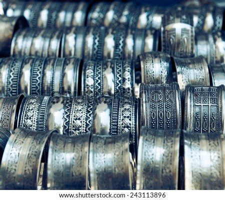 Traditional metal bracelets on the market of Tunisia - stock photo