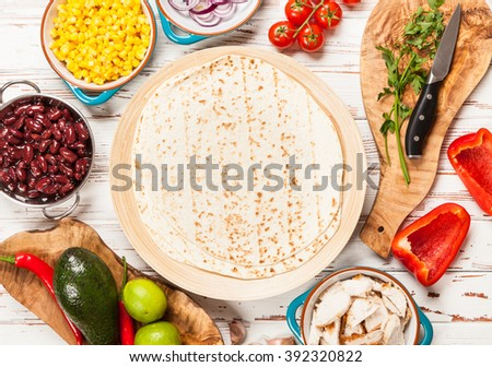 Traditional mexican tortilla with a mix of ingredients - stock photo