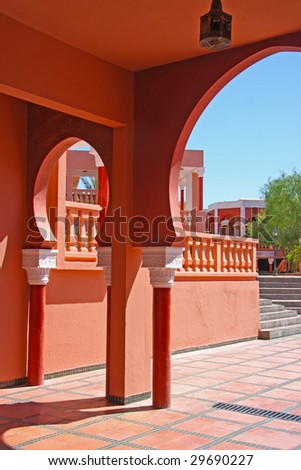 Traditional Moroccan architecture with ornate arches, in Marrakesh - stock photo