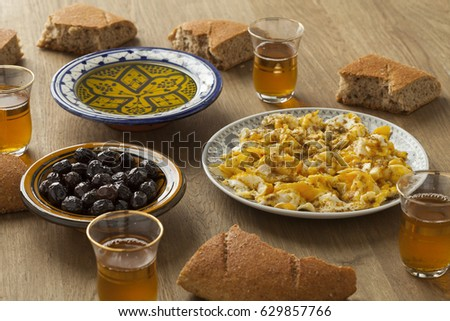 Traditional Moroccan Breakfast With Bread Eggs Olives Olive Oil And Mint Tea