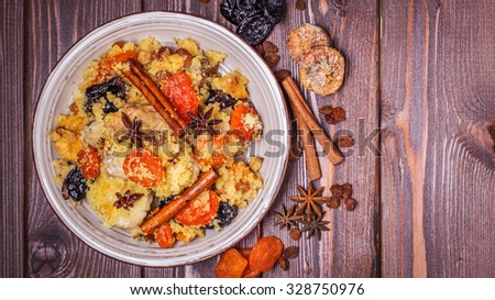 Traditional moroccan chicken with dried fruits and spices, selective focus, top view. - stock photo