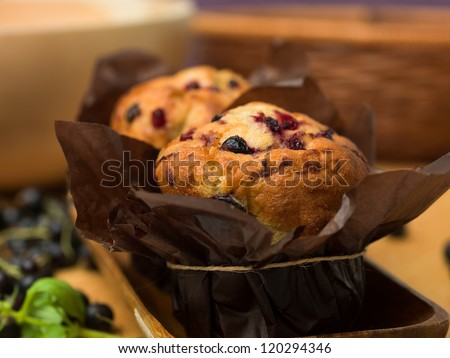 traditional muffins blackcurrant pleasant in wood - stock photo