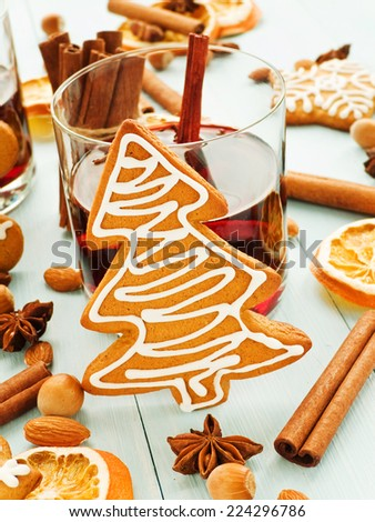 Traditional mulled wine with gingerbread cookies. Shallow dof.  - stock photo
