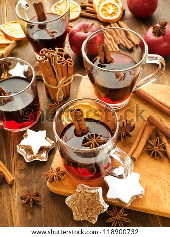 Traditional mulled wine with spices and cookies. Shallow dof. - stock photo
