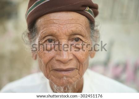Traditional Myanman Old man - stock photo