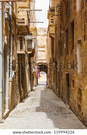 Traditional narrow street in Malta. Maltese architecture in Valletta, Malta - stock photo