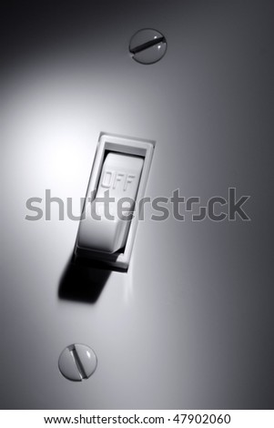Traditional North American toggle electric light switch in OFF position - stock photo