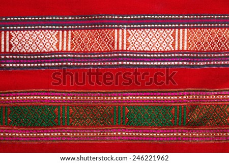 Traditional northern and northeastern Thai style handmade fabric weave  by interweave process represent the textile surface texture background. - stock photo