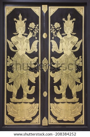 Traditional northern Thai style church door - stock photo