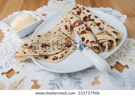 Traditional Norwegian holiday lefse served with butter - stock photo