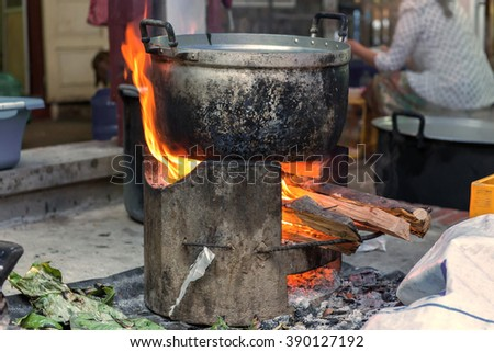 Traditional of making food with Pots on the stove over a natural fire for cooking.