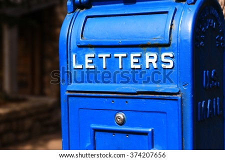 Traditional Old Blue mail letter box - stock photo