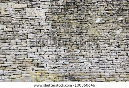 traditional old dry stone wall in cotswolds village of bilbury gloucestershire england - stock photo