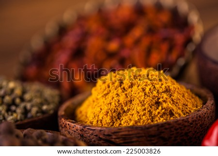 Traditional oriental spices in Indonesian bowls - stock photo