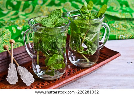 Traditional Oriental tea with mint leaves in a glass - stock photo