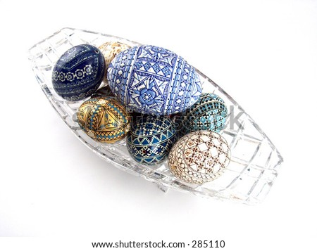 traditional painted eggs on cristal plate