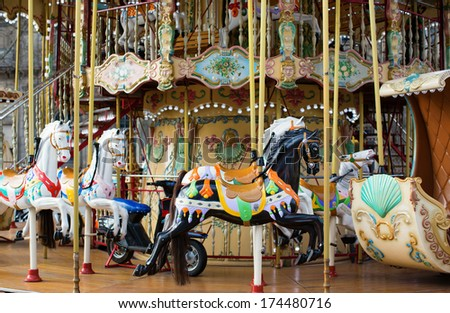 Traditional Parisian merry-go-round - stock photo