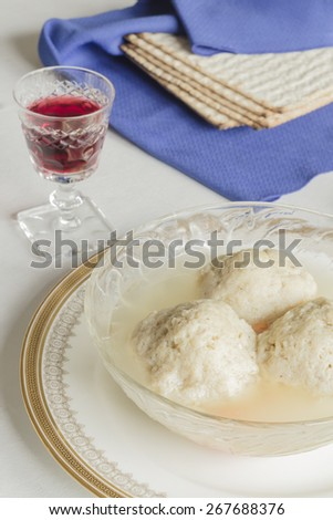 Traditional passover matzoh ball soup with unleavened bread and wine - stock photo