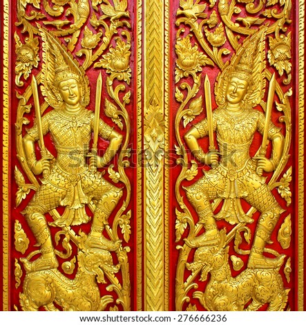 Traditional pattern Thai style of temple door in temple - stock photo