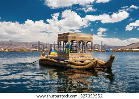 Traditional Peruvian Boat On Titicaca Lake - stock photo