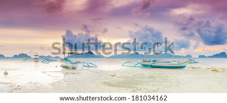 Traditional philippine boats bangka at sunset time. Panorama - stock photo