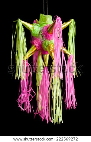 traditional pinata star shape from mexico isolated on black background, important part of parties and celebrations in mexican culture, very popular during posadas parties and independence day  - stock photo