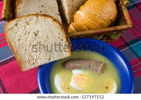 traditional polish white borscht with eggs and sausage - stock photo